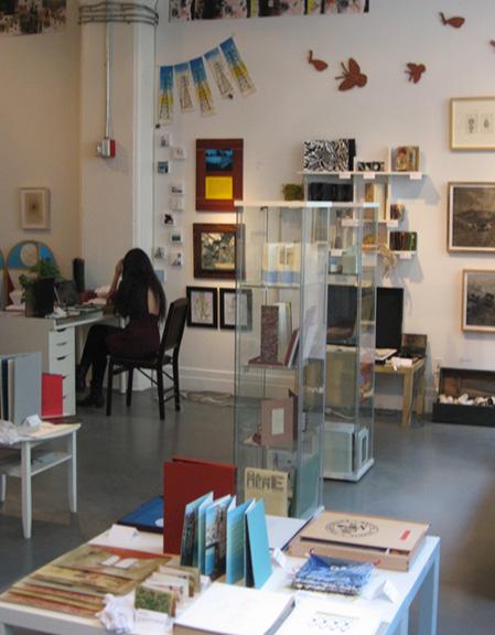 maddy-at-desk-in-gallery-iweb.jpg